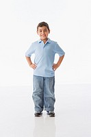Studio shot of Hispanic boy with hands on hips
