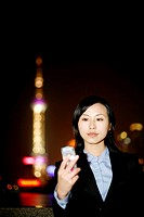 Businesswoman text messaging on the mobile phone