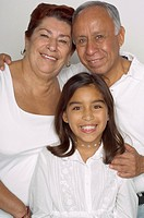 Portrait of Hispanic grandparents and granddaughter