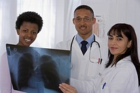 Multi-ethnic doctors and patient looking at x-ray