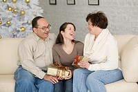 Hispanic family exchanging gifts on Christmas