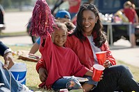 Mother and daughter 5-7 having picnic before game