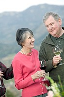 Senior couple having wine at party