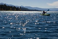 Woman kayaking on Lake Tahoe, California