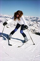 Young woman stopping herself on skis