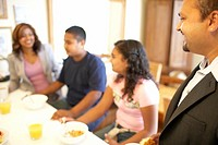 Family of Indian ethnicity eating breakfast