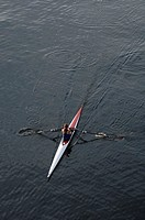 Woman rowing sculling boat
