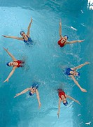 Synchronized swim team performing