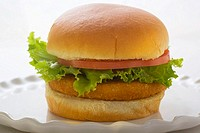 Chicken burger with tomato and lettuce