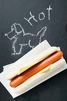 A hot dog on a blackboard with drawing