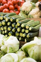 Courgettes, lettuces, cauliflowers & tomatoes at a market