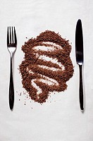 Grated chocolate between knife and fork
