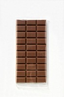 A bar of milk chocolate in cellophane