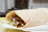 D&#246;ner wrap on paper napkin in snack bar
