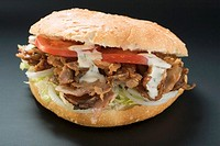 D&#246;ner kebab with onions, tomatoes and yoghurt sauce