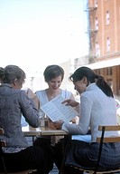 Women reading menu at outdoor restaurant