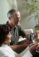 Mature couple looking at photographs