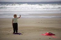 Child and kite on beach