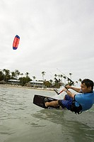 Man kiteboarding on ocean in Islamorada, Florida