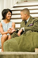 African military soldier talking to wife
