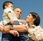 Hispanic military soldier hugging her family