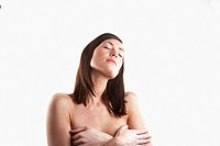 Bare chested woman covering her breasts