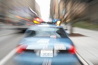 Blurred view of police car