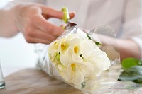 Food server cutting open bouquet of flowers