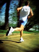 Blurred man jogging