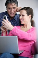 Woman showing cell phone to husband