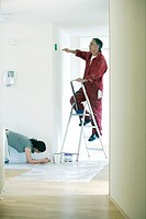 Couple painting walls (thumbnail)
