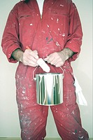 Man holding paint can