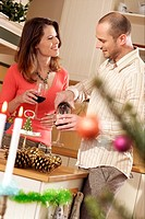 Couple drinking red wine in the kitchen