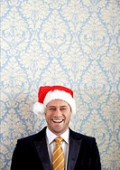 Smiling man in Santa hat
