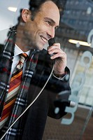 Businessman talking on a pay phone