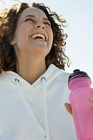 Woman laughing with water bottle