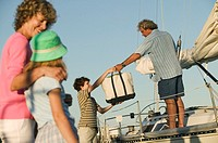 Family loading up boat