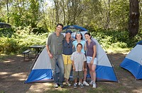 Family posing in campsite