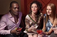Group of young adults sitting at nightclub
