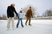 Family ice skating hand-in-hand