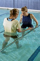 Woman having physical therapy in pool