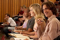 Male student smiling in auditorium