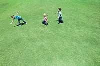 Children playing on grass, high angle view