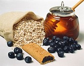 Rolled oats, blueberries, blueberry slice and honey
