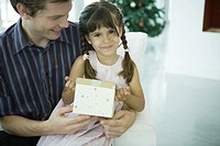Man holding daughter Christmas present