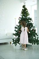 Girl decorating Christmas tree