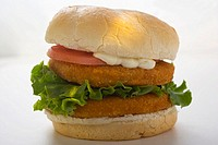 Double chicken burger with tomato, mayonnaise and lettuce