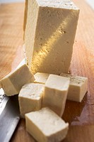 Block of tofu, diced tofu and Asian knife
