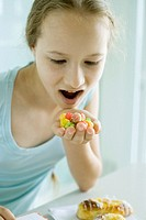 Girl eating sweets