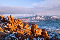 The La Sal mountains and the fins of the Fiery Furnace awash in sunset color, Arches National Park, Utah, USA